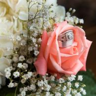 Crockette's Images Wedding Photography- Bridal bouqet with pink roses and wedding rings inside the f