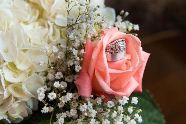 Crockette's Images Wedding Photography- Bridal bouqet with pink roses and wedding rings inside the f]