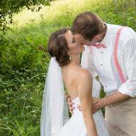 Crockette's Images Wedding Photography- Outdoor wedding photo of bride and groom kissing.