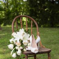 Crockette's Images Wedding Photography- Outdoor photo of brides shoes and bouqet.
