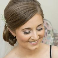 Crockette's Images Wedding Photography- Photo of smiling bride getting ready for her wedding.