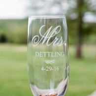 Crockette's Images Wedding Photography- Photo of a wine glass with wedding rings inside.