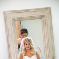 Crockette's Images Wedding Photography- Indoor photo of a bride looking in the mirror.