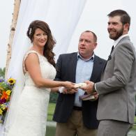 Crockette's Images Wedding Photography- Ceremony photo of bride and groom holding hands.