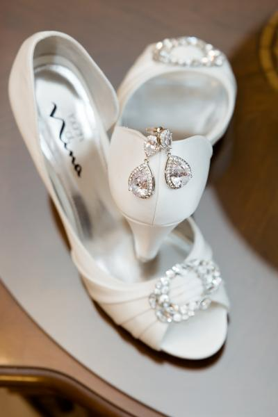 Crockette's Images Wedding Photography- Photo of bride's shoes with jewelry inside. ]