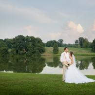 Crockette's Images Wedding Photography- Outdoor photo of bride and groom with water behind them, and