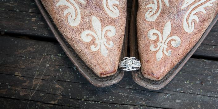 Crockette's Images Wedding Photography- Brides cowboy boots with her wedding ring in the middle.