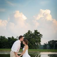 Crockette's Images Wedding Photography- Outdoor photo of bride and groom with a blue sky and clouds.
