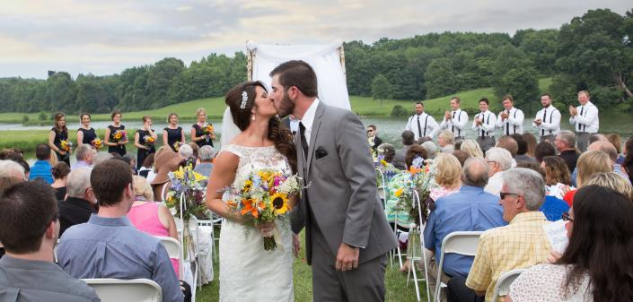 Crockette's Images Wedding Photography- Outdoor wedding photo of bride and groom kissing.]