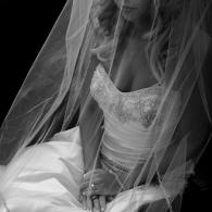 Crockette's Images Wedding Photography- Black and white bridal photo sitting with veil in front of h