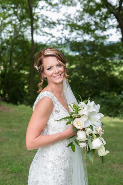 Crockette's Images Wedding Photography- Outdoor wedding photo a bride holding her bouqet]