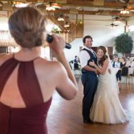 Crockette's Images Wedding Photography- Indoor wedding reception photo of the bride laughing during