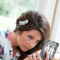 Crockette's Images Wedding Photography- Photo of the bride doing her makeup before the wedding