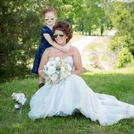 Crockette's Images Wedding Photography- Outdoor wedding photo of the bride and her flowergirl.
