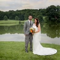 Crockette's Images Wedding Photography- Outdoor photo of bride and groom in front of water.