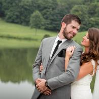 Crockette's Images Wedding Photography- Outdoor photo of bride and groom in front of water, looking