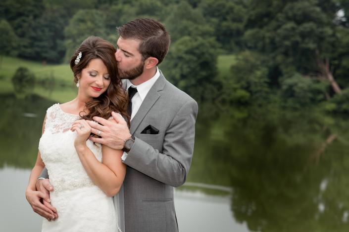 Crockette's Images Wedding Photography- woodsy bride and groom kissing and holding hands