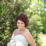 Crockette's Images Wedding Photography- Outdoor photo of a bride holding her bouqet.