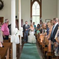 Crockette's Images Wedding Photography- Indoor wedding ceremony of bride walking down the aisle with