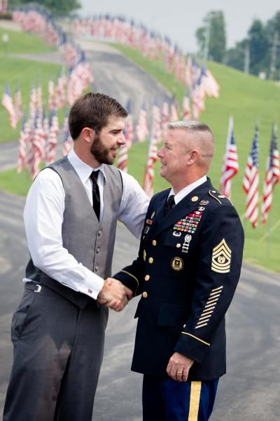 Crockette's Images Wedding Photography- Military wedding photo of groom shaking is fathers hand.