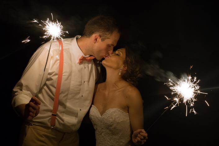 Crockette's Images Wedding Photography- Bride and groom kissing with sparklers.