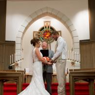 Crockette's Images Wedding Photography- Photo of an indoor wedding ceremony and bride and groom hold