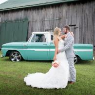 Crockette's Images Wedding Photography- Outdoor wedding photo of bride and groom with an antique tru