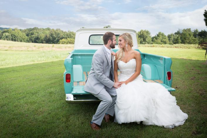 Crockette's Images Wedding Photography- Outdoor wedding photo of a bride and groom with an antique t