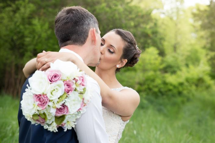 Crockette's Images Wedding Photography- Outdoor wedding photo of a bride and groom kissing.