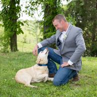 Crockette's Images Wedding Photography- Outdoor wedding photo of a groom and his dog.