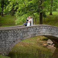 Crockette's Images Wedding Photography- Outdoor wedding photo of the bride and groom kissing on a br