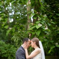 Crockette's Images Wedding Photography- Outdoor wedding photo of the bride and groom touching heads
