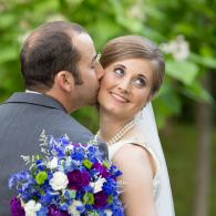 Crockette's Images Wedding Photography- Outdoor wedding photo of the groom kissing the bride on the
