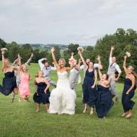 Crockette's Images Wedding Photography- fun outdoor wedding party photo of everyone jumping.