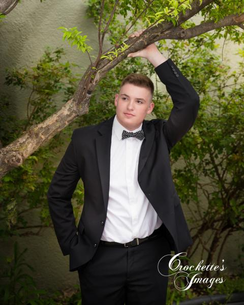 senior photo in tux]