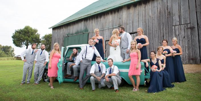 Crockette's Images Wedding Photography- Outdoor wedding party photo with an antique truck.]