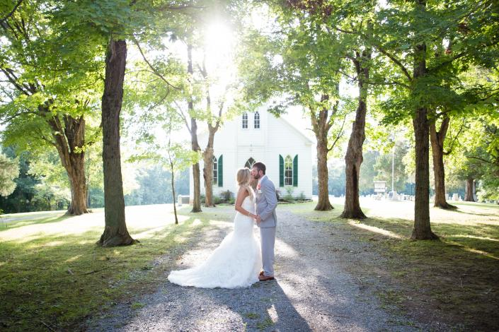 Crockette's Images Wedding Photography- Outdoor wedding photo of a bride and groom with a light beam