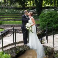 Crockette's Images Wedding Photography- Outdoor photo of bride and groom kissing on a bridge.