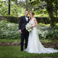Crockette's Images Wedding Photography- Outdoor photo of the bride and groom in front of green trees
