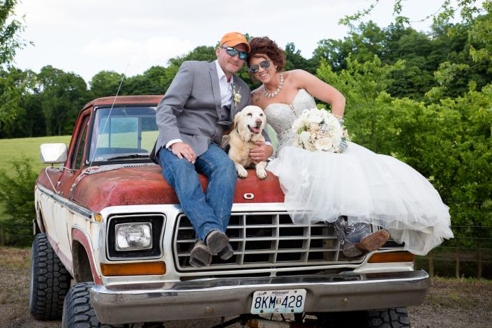 Crockette's Images Wedding Photography- Outdoor wedding photo of the bride, groom and their dog, wit