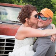 Crockette's Images Wedding Photography- Outdoor wedding photo of the bride and groom with an antique