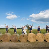 Crockette's Images Wedding Photography- Outdoor wedding photo of the wedding party standing on hay b