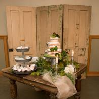 Crockette's Images Wedding Photography- Photo of the cake table at a wedding reception.