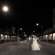 Crockette's Images Wedding Photography- Black and white photo of a bride and groom walking down the