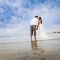 Crockette's Images Wedding Photography- Beach wedding photo with couple standing in the water.