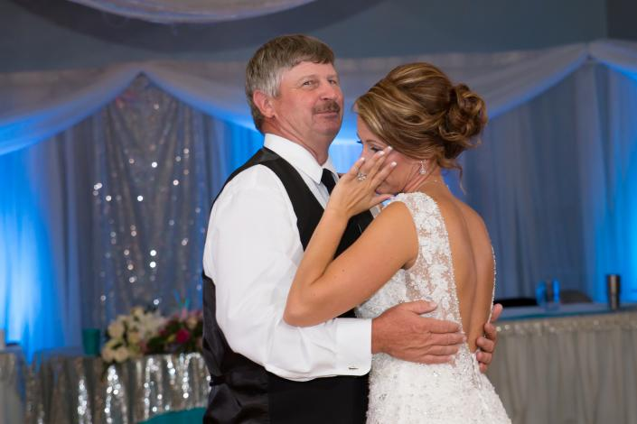 Crockette's Images Wedding Photography- Photo of the bride dancing with her father at the reception.