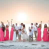 Crockette's Images Wedding Photography- Beach wedding bridal party photo with sunset in the back.