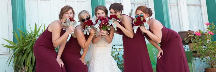 Crockette's Images Wedding Photography- Wedding photo of a bride with her bridesmaids.