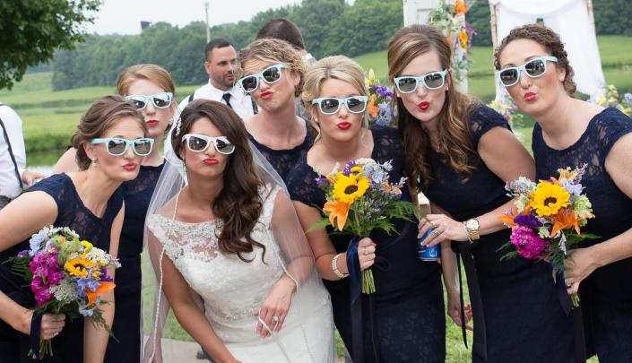 Crockette's Images Wedding Photography- Photo of the bride and her bridesmaids posing in sunglasses.