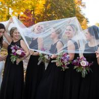 Crockette's Images Wedding Photography- laughing bridal party under brides veil photo, outdoors with
